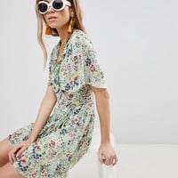 Glamorous Mini Wrap Dress With Ruffle Hem And Tie Waist In Ditsy Floral at asos.com