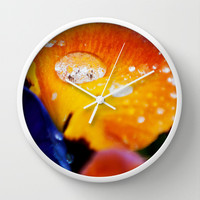 Water droplet on bright and vibrant Pansy flowers Wall Clock by Karl Wilson Photography
