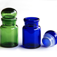 Set of 2 Vintage Apothecary chemist glass bottles with lid, blue and green jars
