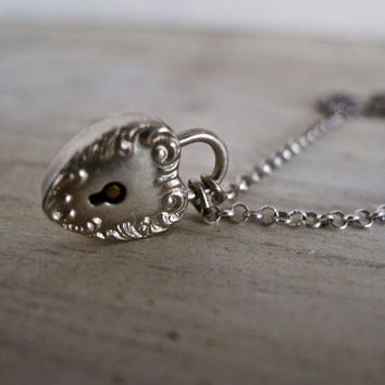 antique heart lock. stainless steel chain. antique heart padlock. padlock necklace.
