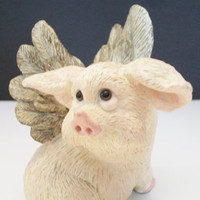 Pete Apsit flying pig, pig figurine, winged pig, when pigs fly, pig with wings