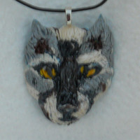 Native American Wolf Pendant is designed ,hand sculpted ,by me .This can be worn by a man ,women,teens. The colors are gray yellow in eyes