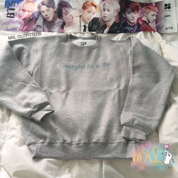 Caught in a Lie crewneck sweatshirt