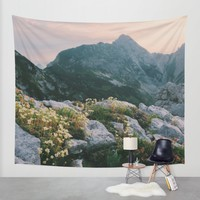 Mountain flowers at sunrise Wall Tapestry by Bor Cvetko