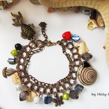 Brown bracelet with pendants and seashells in Marine style Goldfish