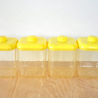 Vintage Lustro Ware Plastic Kitchen Canisters , Set of Four , Clear with Yellow Lids . Mid-Century