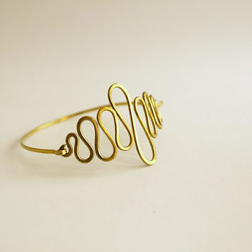 Golden wave bracelet, Hammered brass bangle