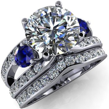 Orion Round Moissanite 2 Round Blue Sapphire Sides Split Shank Diamond Channel Set Ring