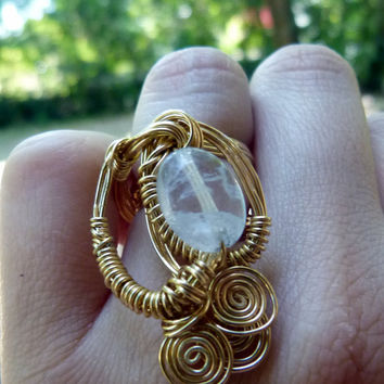 Clear quartz crystal ring, wire arapped in nugold brass wire , statement swirl ring , small ooak design , handmade ring