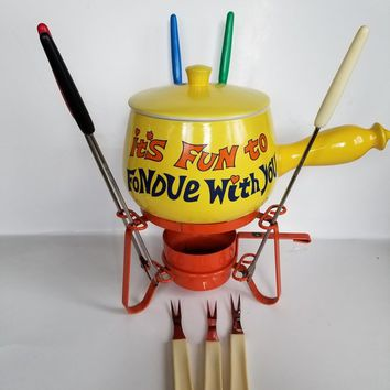 Fondue pot in vintage yellow. With sterno pot and forks