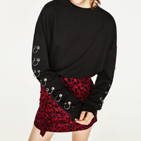 SWEATSHIRT WITH METALLIC RINGSDETAILS