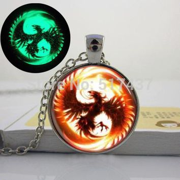 Glowing  Phoenix Mythical fire bird Glass Dome Necklace. glow in the dark
