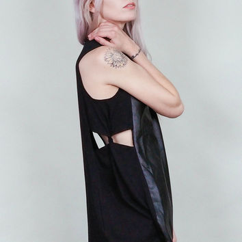 Twisted - Vegan leather tunic shirt with twisted cut out sides