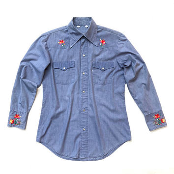 Vintage 1970s men's long sleeved, blue, press stud western shirt with intricate floral hand embroidery