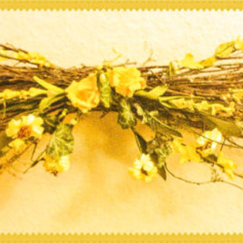 wall decor...Floral swag made with twigs and yellow flowers and accents.