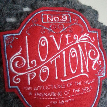 Gray slouch beanie with love potion embroidered patch applique