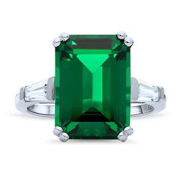 A Perfect 8.8CT Emerald Cut Emerald & Step Cut Trapezoid Engagement Ring