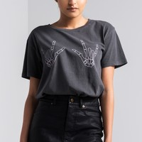 AKIRA Buttoned Faux Leather Mini Skirt in Black