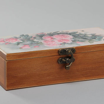 Handmade rectangular wooden jewelry box with floral print on a lid