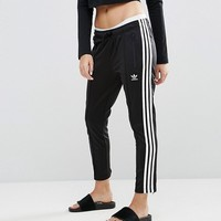 adidas Originals Three Stripe Cigarette Pants In Black at asos.com