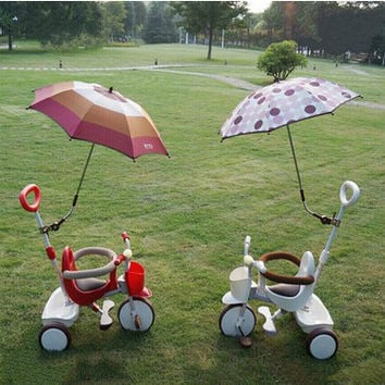The baby foot children tricycle stroller toy car presented a sunshade children bicycle