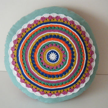 Handmade decorative pillow with crochet mandala