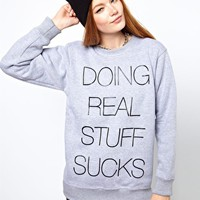 Local Heroes Doing Real Stuff Sucks Sweatshirt at asos.com