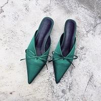 Slip on pointed toe kitten heels with bowtie accent