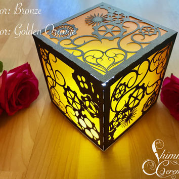 Steampunk luminary lantern table centerpiece gears and hearts lighting wedding themed party decor