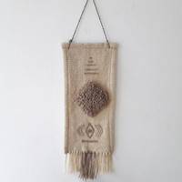 Unique white handwoven wall hanging with beige motifs your home decor by Rugs N' Bags