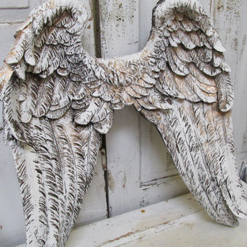 Large angel wings wall sculpture hand painted white accented gold ornate detailed feathered wall decor Anita Spero
