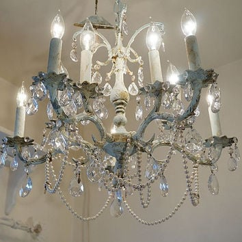 Large ornate chandelier lighting crystal light blue distressed ceiling fixture 10 arms adorned vintage pearls necklaces anita spero design