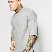 ASOS | ASOS Oversized Short Sleeve Sweatshirt With Side Zips at ASOS