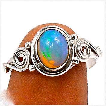 Natural Ethiopian Opal ring. Vivid genuine Opal Gemstones. Set in Sterling Silver setting