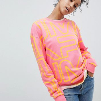 Puma Exclusive To ASOS Sweatshirt With All Over Logo In Pink at asos.com