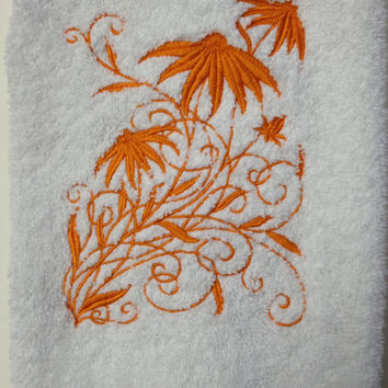 Orange Black-eyed Susan Embroidered on a white bath hand towel.