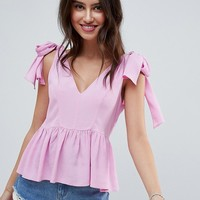 ASOS DESIGN relaxed cami with tie shoulder at asos.com