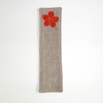 Handmade flower bookmark. Embroidered bookmark with red orange flower design on natural linen, with red orange fabric back