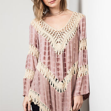 This cute tie dye gauze tunic top features a beautiful knit crochet panel with cotton blended construction, knit crochet v-neckline, long sleeves insert with knit crochet detailing, and crochet hemline. Unlined. Pair with skinny jeans, denim cut off and el