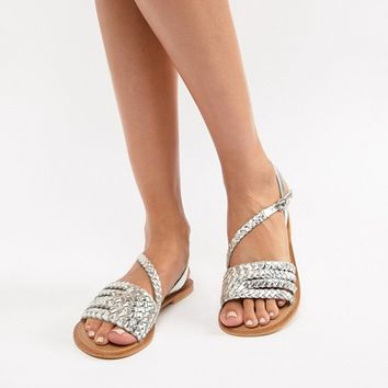 ASOS DESIGN Farthing plaited asymmetric flat sandals at asos.com