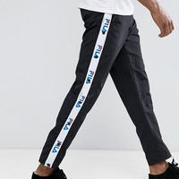 Fila Black Joggers With Logo Taping Exclusive To ASOS at asos.com