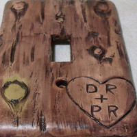 Carved love initials in a Bark of a tree light switch cover