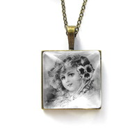 Pendant charm with glass and chain. Vintage. Girl with pansy.