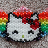 Glow Hello Kitty Kandi Mask on clear bead background