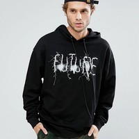 ASOS Oversized Longline Hoodie With Logo In Black at asos.com