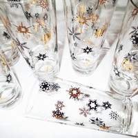 Mid Century Bar Ware Starburst Highball or Pilsner Barware, Mid Century, gold and black embossed snowflake or starburst design