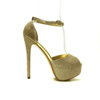 Get glamorous in these delightful platform heels! Featuring peep toe, gold glitter upper/leatherette underling with sparkling rhinestones embellishment back to stiletto heel, ankle strap design, hidden platform. Finished with lightly padded insole and adju