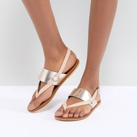 Warehouse Metallic Leather Flat Sandals at asos.com