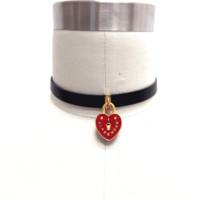 "I Surrender Choker makes you all choked up cause you won't ever wear yer heart on yer sleeve again. This sick choker is totes 90's with it's red enamel heart locket with ""I Surrender"" printed on the face and Me and Zena printed on the back so you know it's"