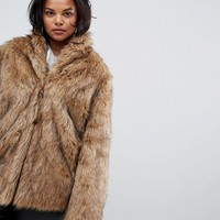 ASOS DESIGN Curve stand collar faux fur coat at asos.com